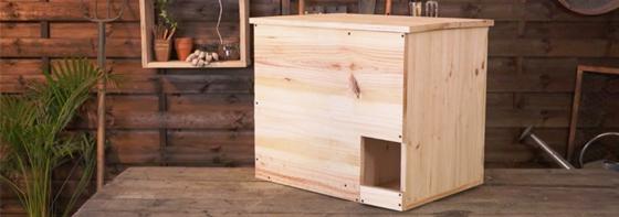 photo d'un nichoir en bois pour les chouettes